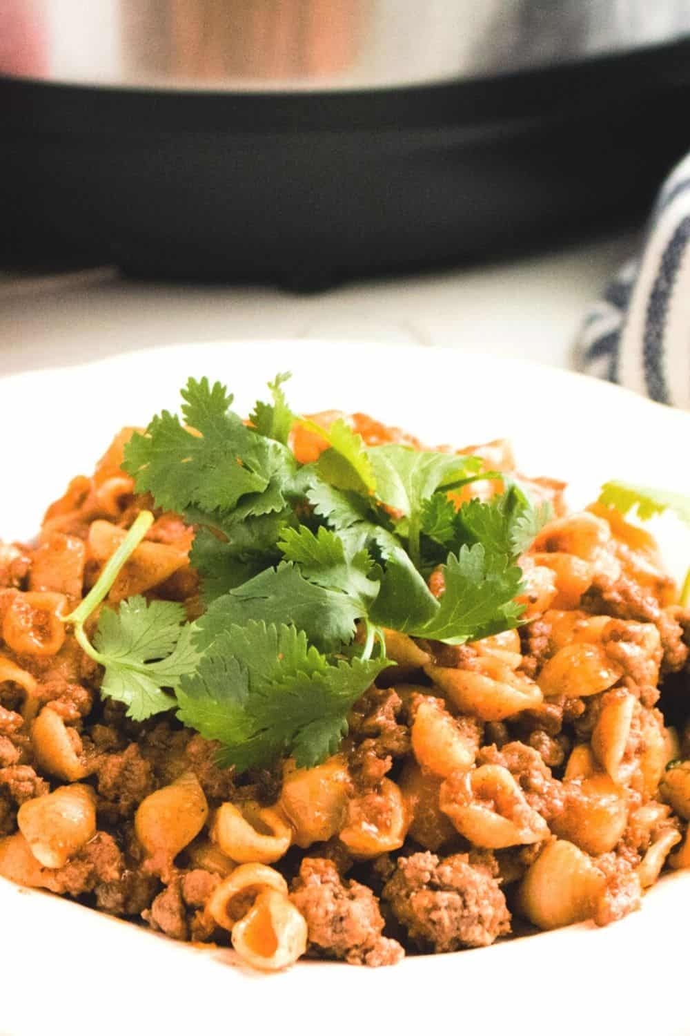 Learn to create this Instant Pot Puerto Rican Cheesy Taco Pasta recipe your family is going to love. Super simple to make and super cheesy! via @mystayathome