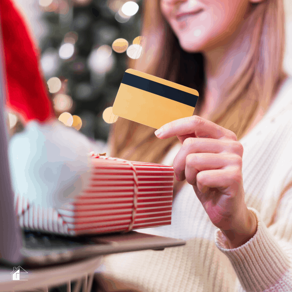 Photo of woman holing a credit card