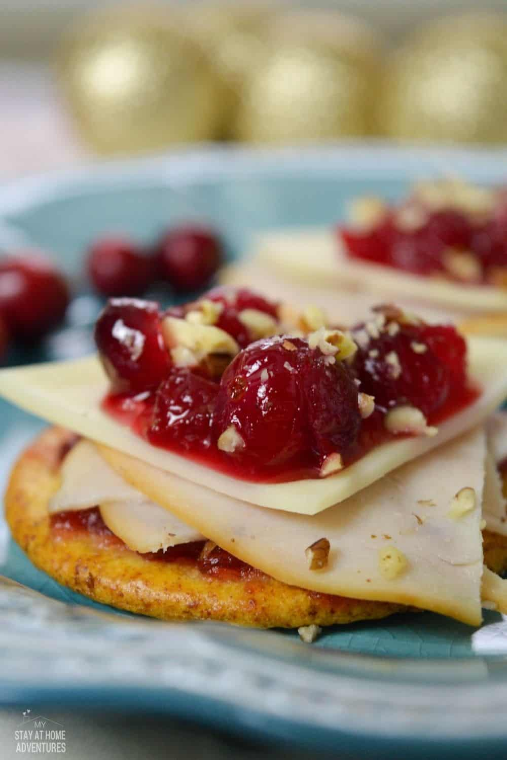 Learn how to make these simple Cranberry Cracker Bites that are great appetizers during your family gatherings. via @mystayathome