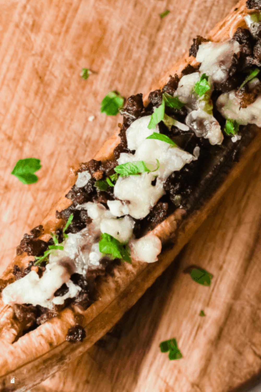 Learn how to make this Puerto Rican stuffed baked plantains or Canoas De Plátanos Maduros that your family is going to love. #plantain #puertoricanfood #stuffplatanos via @mystayathome