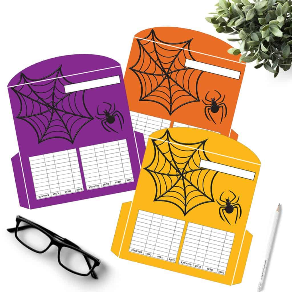 3 Spider and web cash envelopes in orange, purple, and yellow.