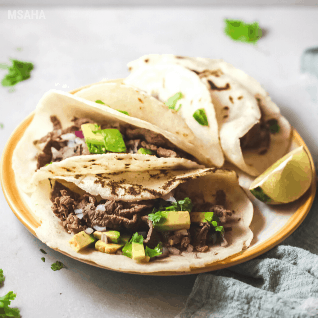 steak tacos with lime on the side