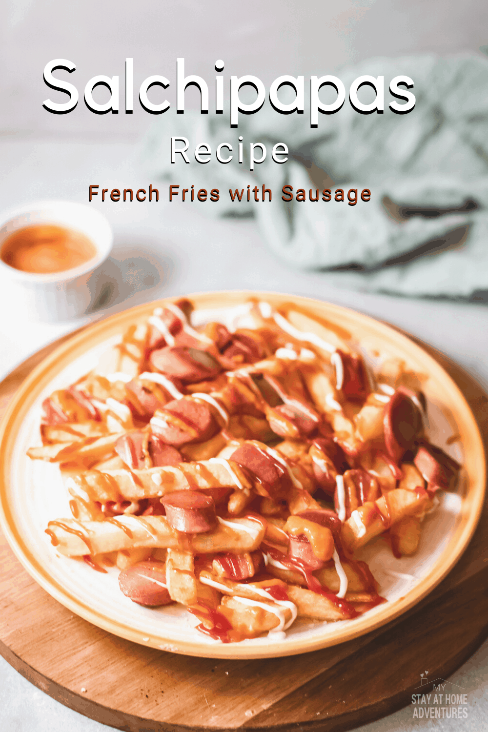 This Peruvian salchipapas recipe is crispy French fries loaded with ahi Amarillo paste and so much more. Fast and easy to make too! #frenchfries #peruvianrecipes #streetfood via @mystayathome