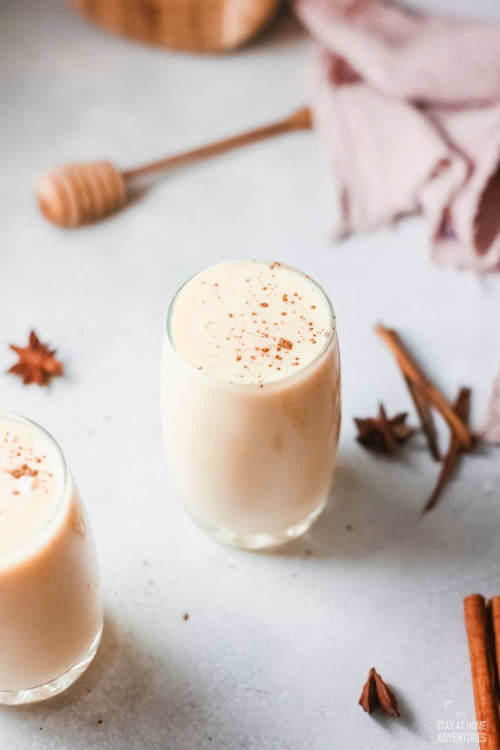 This Ponche de Crema recipe is made with condensed milk, milk, cinnamon stick, lemon zest, egg yolk, nutmeg, cloves, and rum. via @mystayathome
