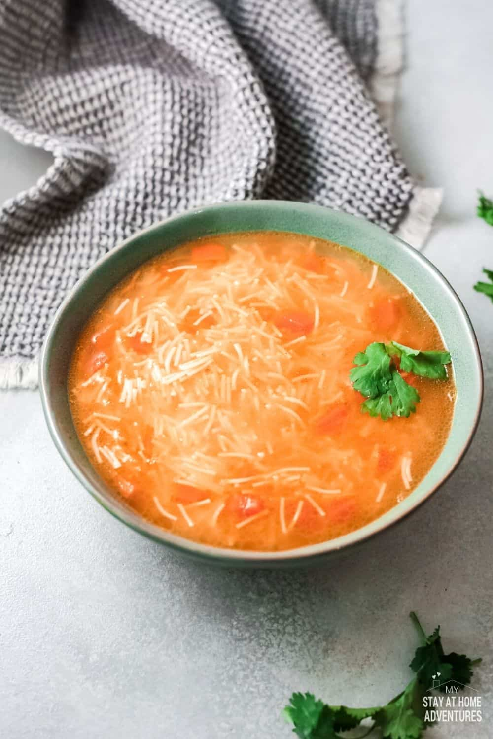 This simple and delicious. Sopa de Fideo made with chicken stock, tomatoes, fideo, onion, and garlic. Learn how to make it here! #soup #Spanishsoup #puertoricansoup #mexicansoup via @mystayathome