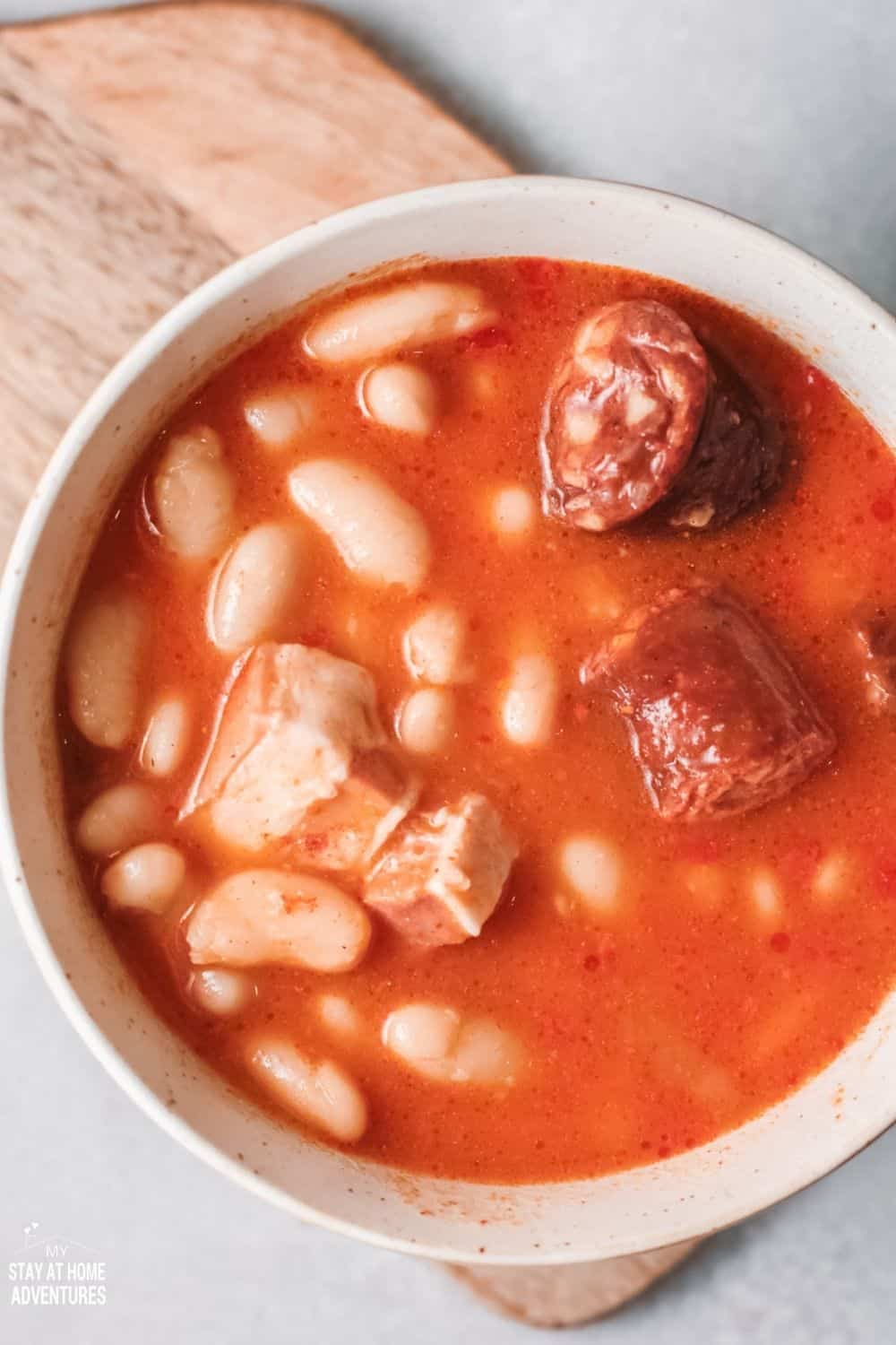 This delicious and hearty Fabada served in a bowl with all those flavorful meat is so comforting especially when served during the cold season. #soup #spanishsoup #fabada via @mystayathome