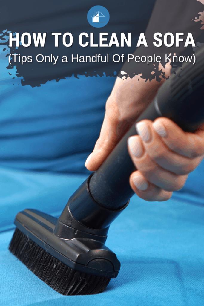 female hand vacuuming a sofa
